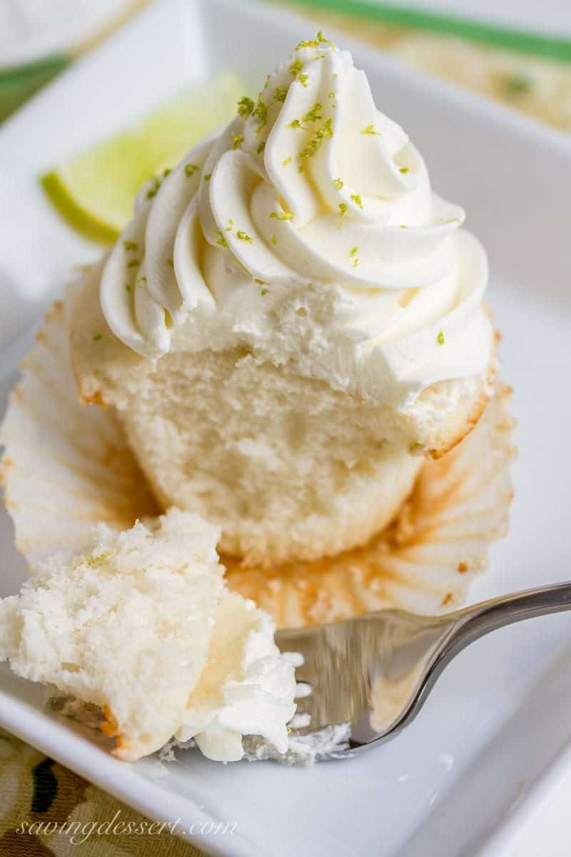 Tender white Lime Cupcakes with Swiss Lime Buttercream and just the right amount of zing from the lime juice www.savingdessert.com