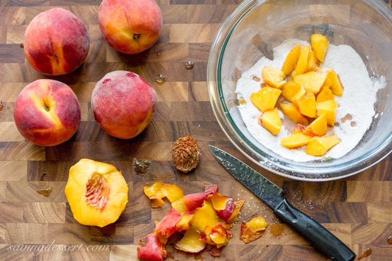 A bowl of diced fresh peaches tossed in sugar
