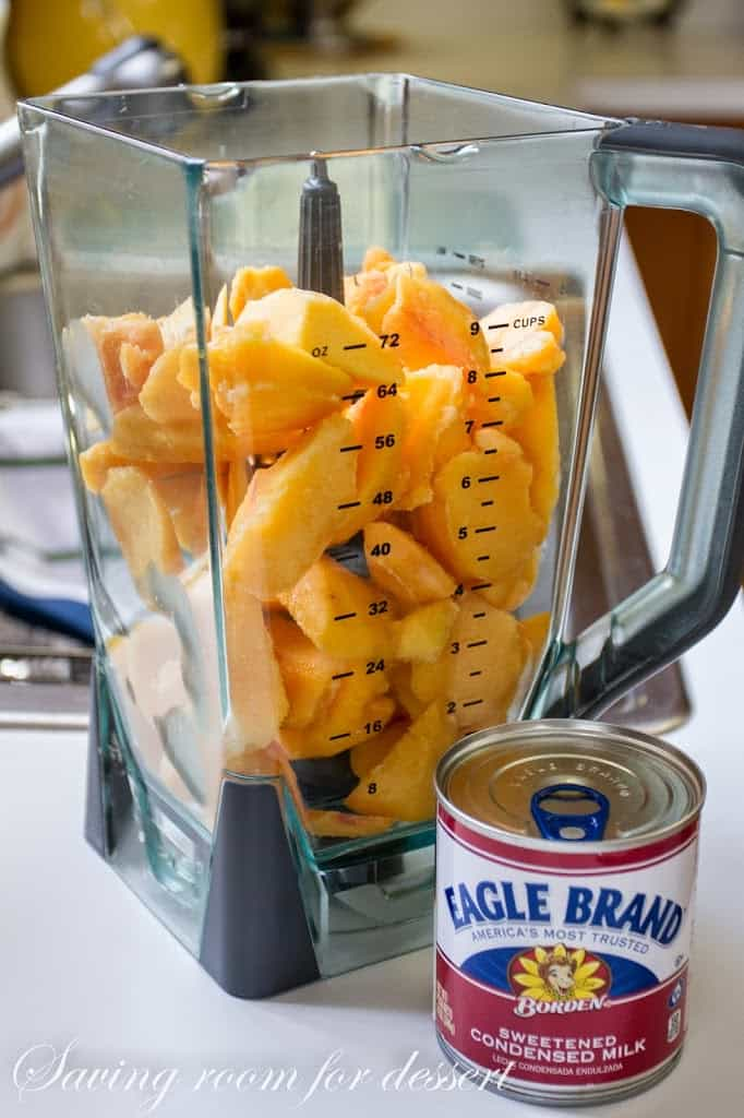 A blender filled with peaches