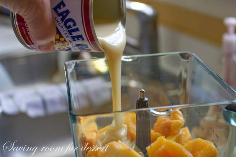 Sweetened condensed milk being poured into a blender
