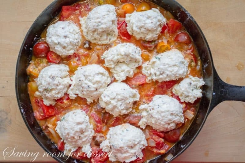 tomato cobbler with herbed biscuit topping ready to go in the oven