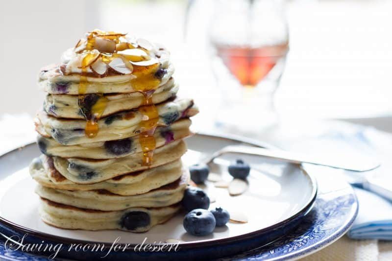 Fluffy Blueberry Greek Yogurt Pancakes ~ stuffed full of juicy ripe blueberries. A great way to start the day! www.savingdessert.com