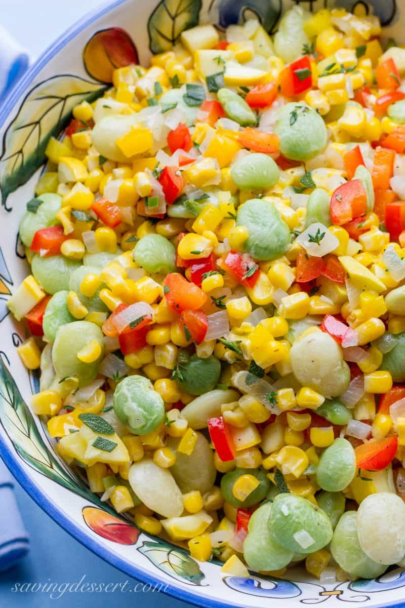 A bowl of summer succotash with lima beans, corn and peppers