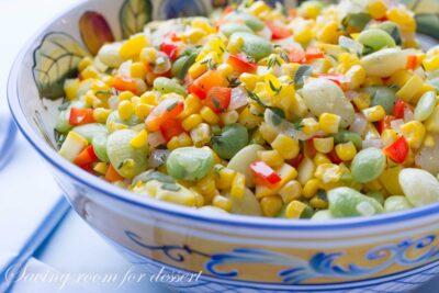 A bowl of summertime succotash amongst lima beans Succotash