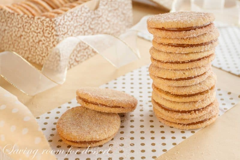 Dulce de Leche Sandwich Cookies with Cinnamon and Cardamom - a sweet, soft cookie coated with the warm flavors of cinnamon and cardamom then filled with a silky rich caramel. www.savingdessert.com #holidaycookies #cookie #dulcedeleche #sandwichcookies #savingroomfordessert