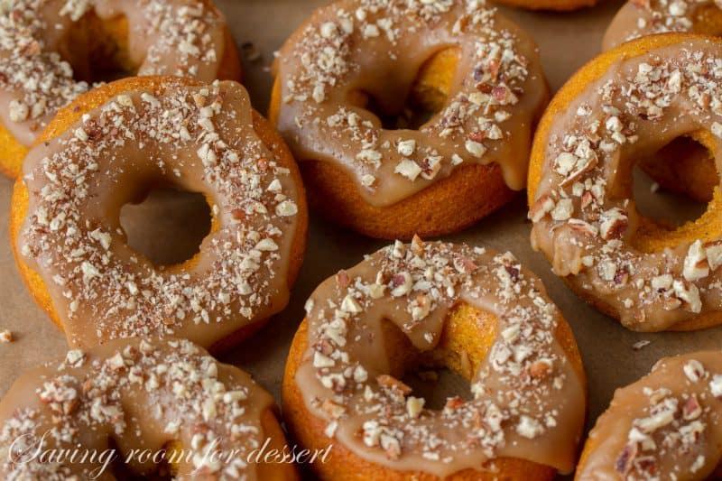 Pumpkin Donuts with Caramel Icing and Toasted Pecans | www.savingdessert.com