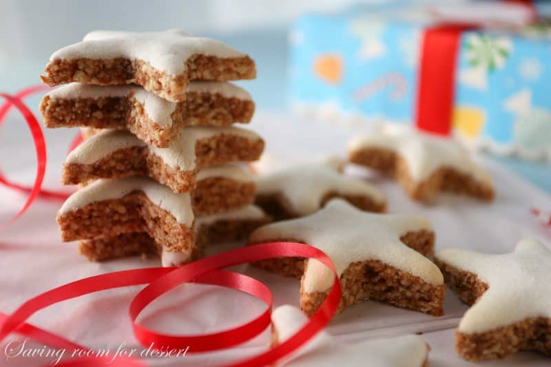A stack of iced star cookies with a ribbon