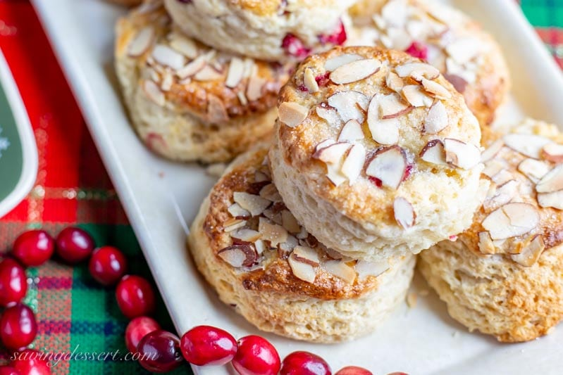 a plate of fresh cranberry scones with almonds