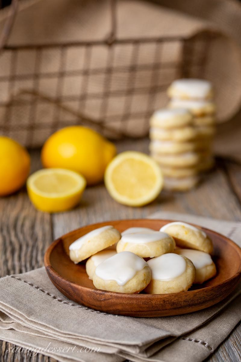 A wooden bowl of lemon meltaway cookies with icing on top