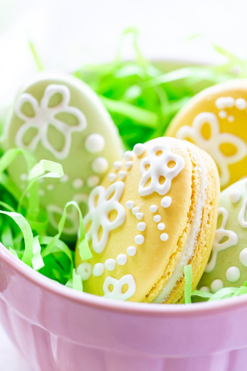 A bowl of simply decorated Easter Egg Macarons