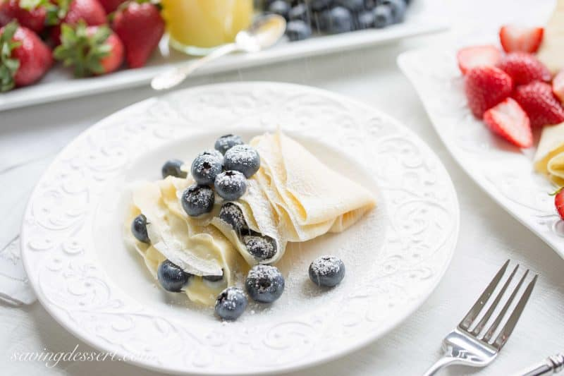 Crepes with Lemon Curd Whipped Cream - Perfectly fresh fruit served with homemade crepes with sweet, tart, bright and creamy lemon curd whipped cream.
