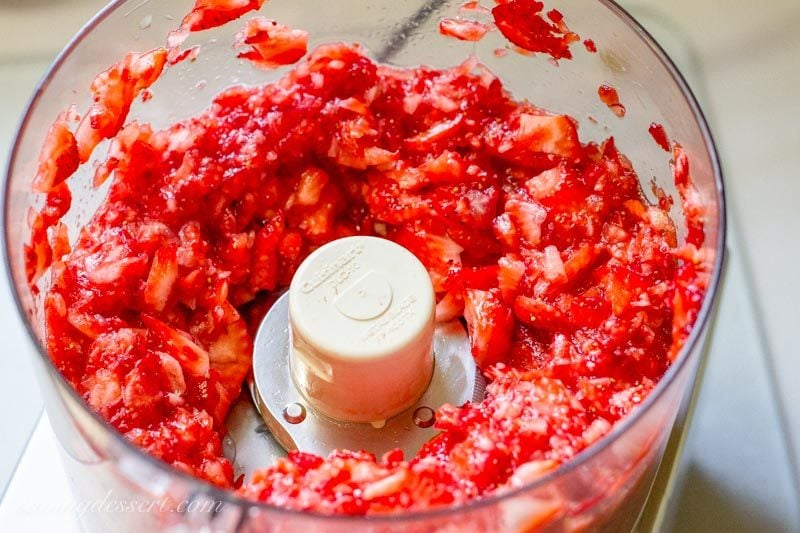red ripe strawberries chopped in a food processor