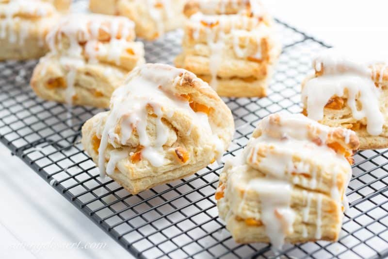 buttery scones layered amongst chopped apricots too iced amongst an almond flavored glaze Buttery Apricot Scone Recipe