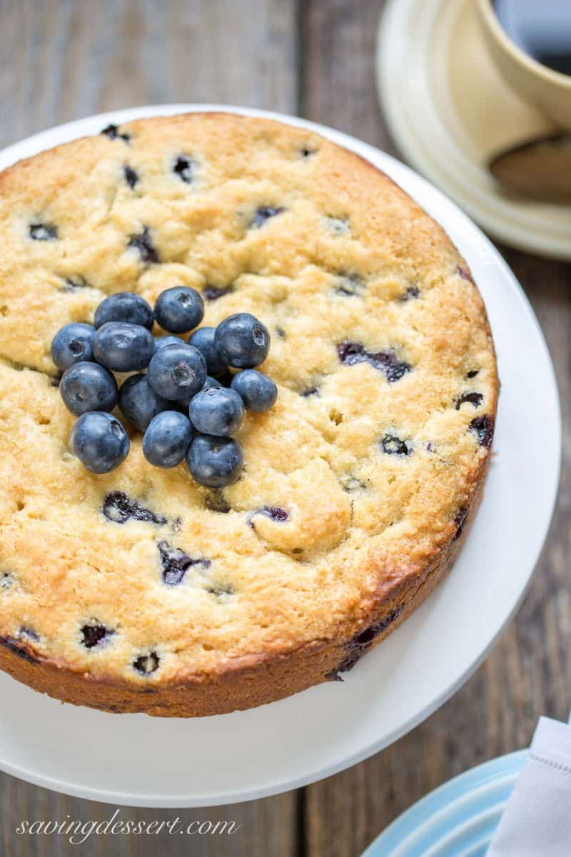 A blueberry breakfast cake with blueberries on top