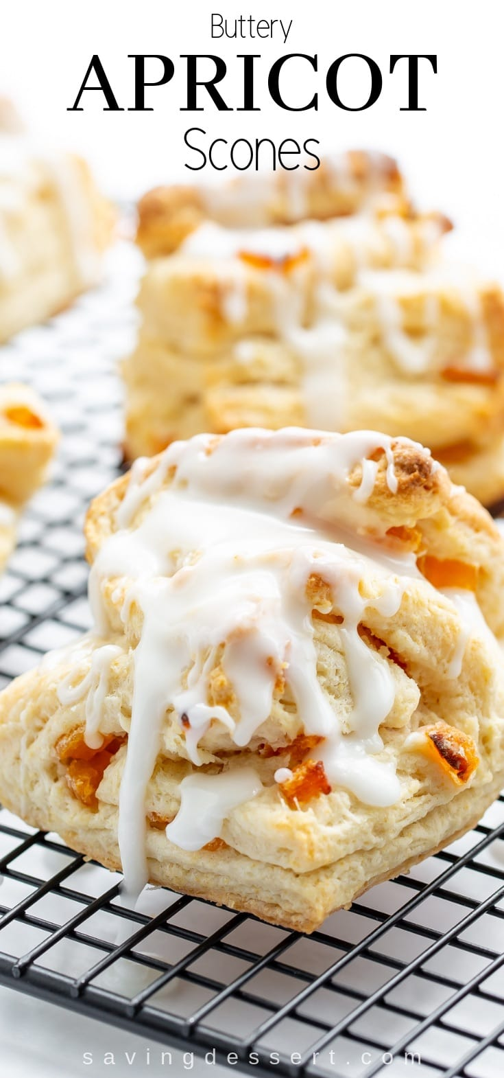 Buttery Apricot Scones ~ A light, flaky, buttery scone layered with chopped apricots and iced with an almond flavored glaze. #apricot #scones #baking #breakfast #brunch #flakyscones