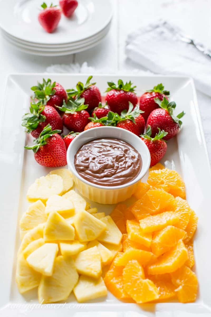 A platter of fresh fruit and a chocolate dulce de leche dip