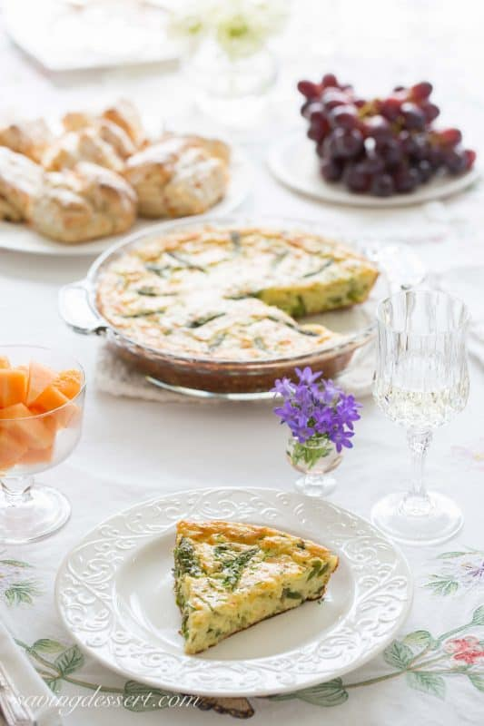 Crustless Asparagus Cheese Pie -A wonderfully easy, and cheesy pie made with eggs, asparagus, and onions. A great brunch recipe served warm or at room temperature.