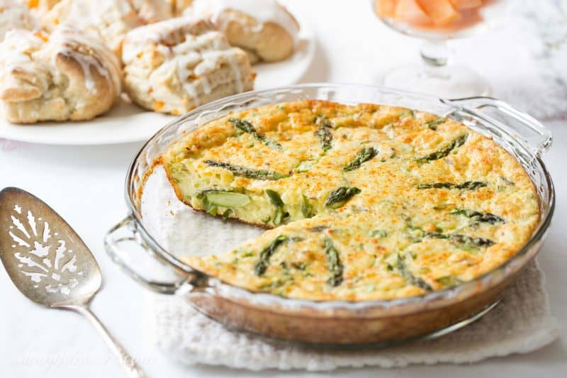 Crustless Asparagus Cheese Pie - A wonderfully easy, and cheesy pie made with eggs, asparagus, and onions. A great brunch recipe served warm or at room temperature.
