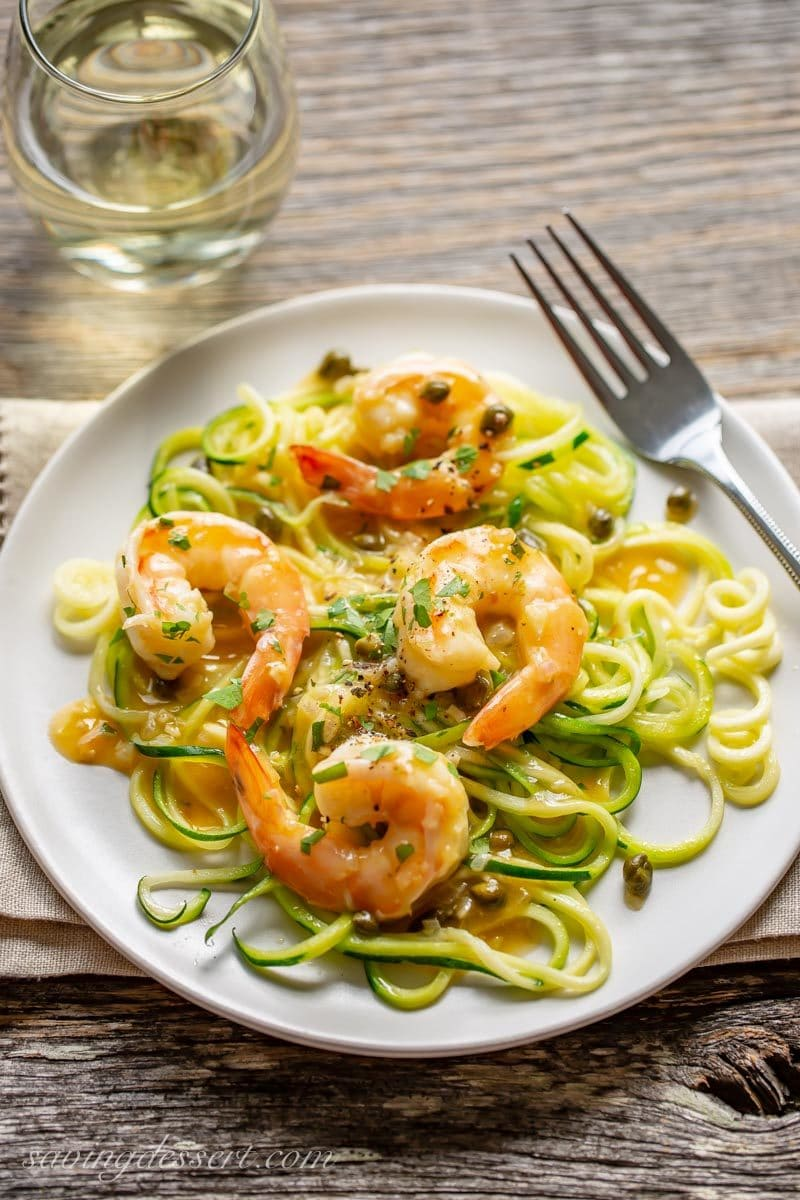 Shrimp Piccata served over zoodles with white wine