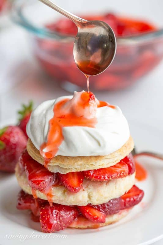 Strawberry Shortcake Scones-Sweet, ripe strawberries spooned between fluffy scone layers, then drizzled with the berry juices and topped with sweetened whipped cream - summer perfection!
