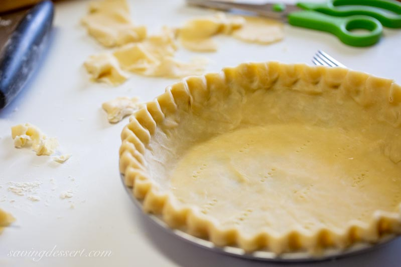 An unbaked pie crust ready for the oven