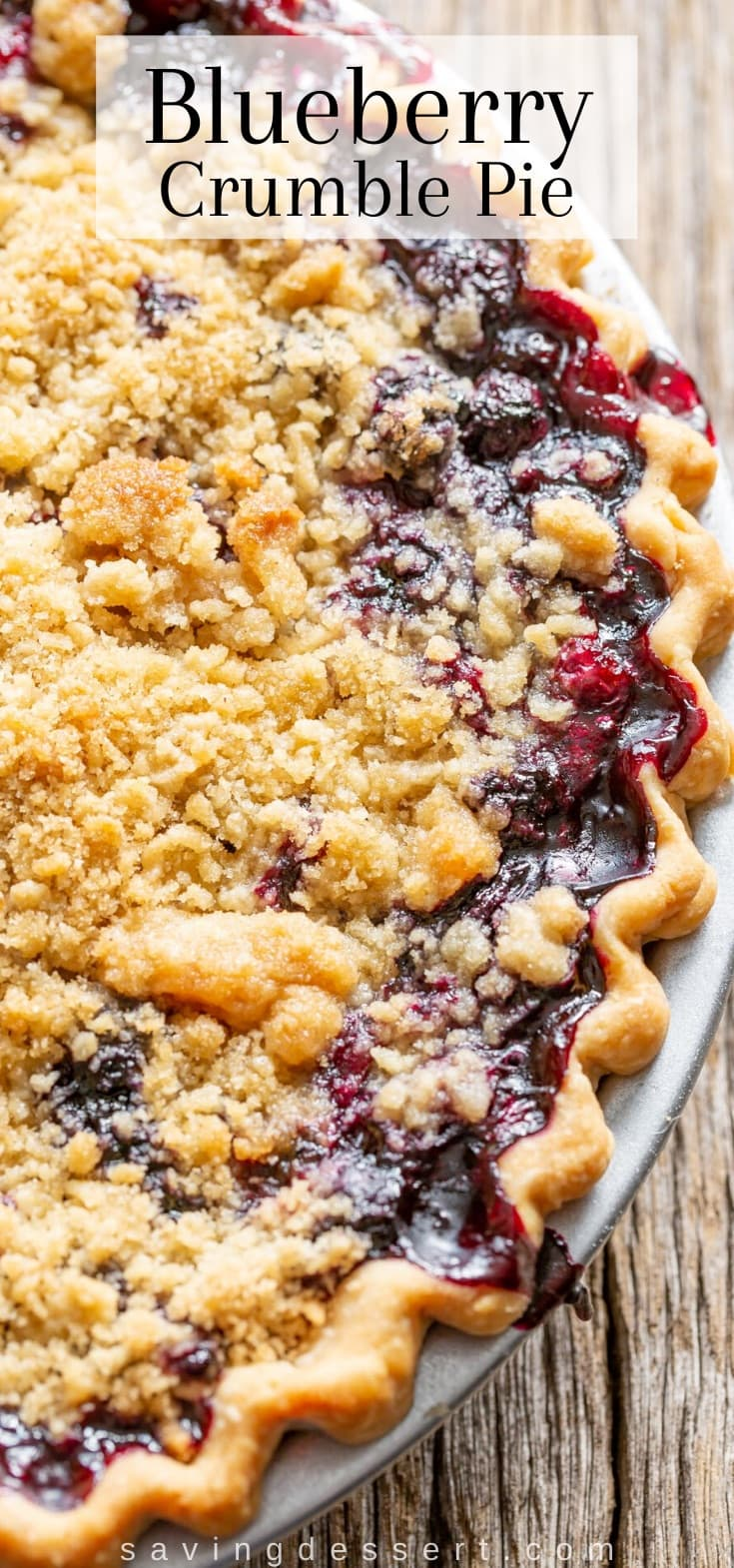 A closeup of a blueberry crumble pie