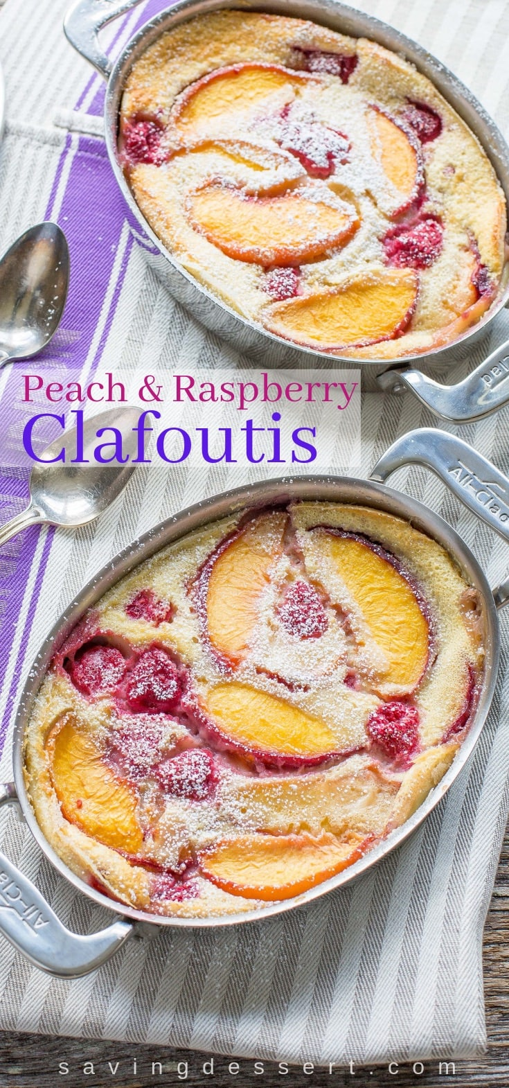 Two casserole dishes with a peach and raspberry custard dessert called a Clafoutis also dusted with powdered sugar