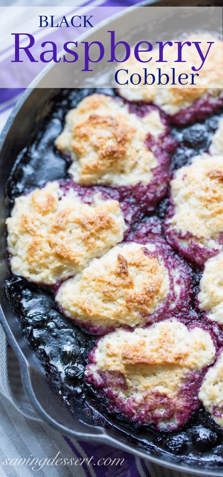 A cast iron skillet with black raspberry cobbler