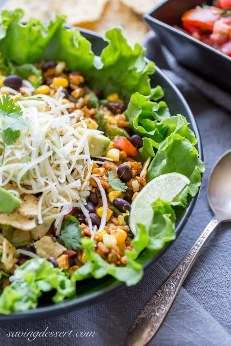 A bowl of meatless Taco salad with chips, corn, black beans and cheese