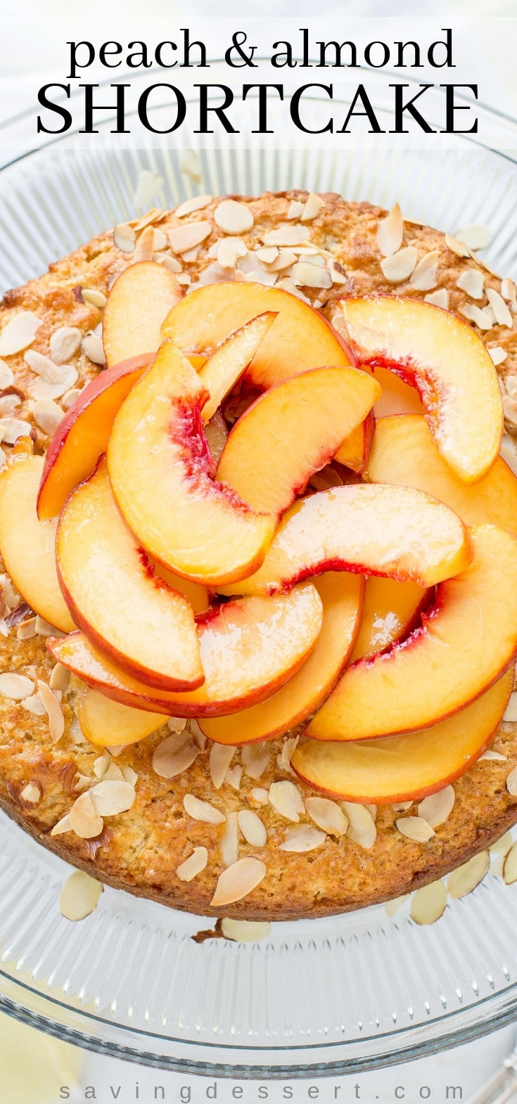 A peach and almond shortcake topped with fresh sliced peaches