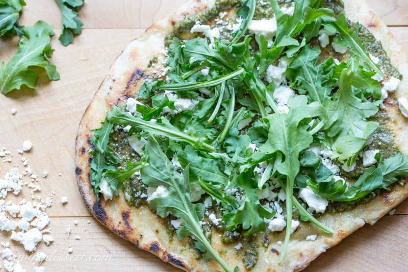 Pesto Grilled Pizza ~A full flavored pizza made with fresh Basil Pesto and peppery arugula. Feta cheese adds a nice creamy bite to this simple but tasty pizza