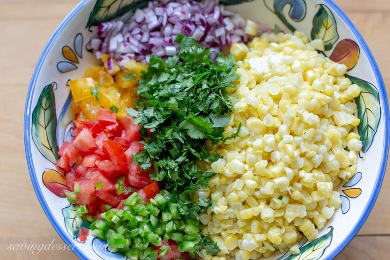 fresh corn, chopped tomatoes, onions and jalapeños with cilantro