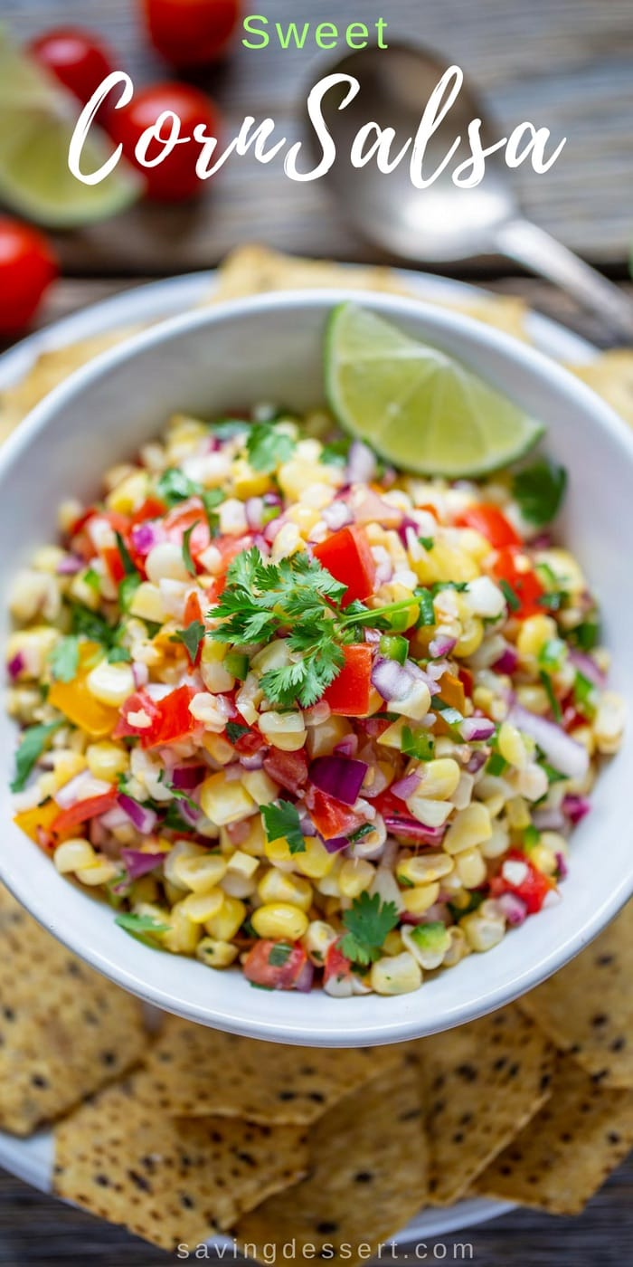 Sweet Corn Salsa - Sweet summer corn is the star of this fresh tasty salsa. Great served with chips, on chicken, fish or tacos - it's great on everything! #savingroomfordessert #corn #salsa #sweetcornsalsa #summercorn #mexican #chipsandsalsa