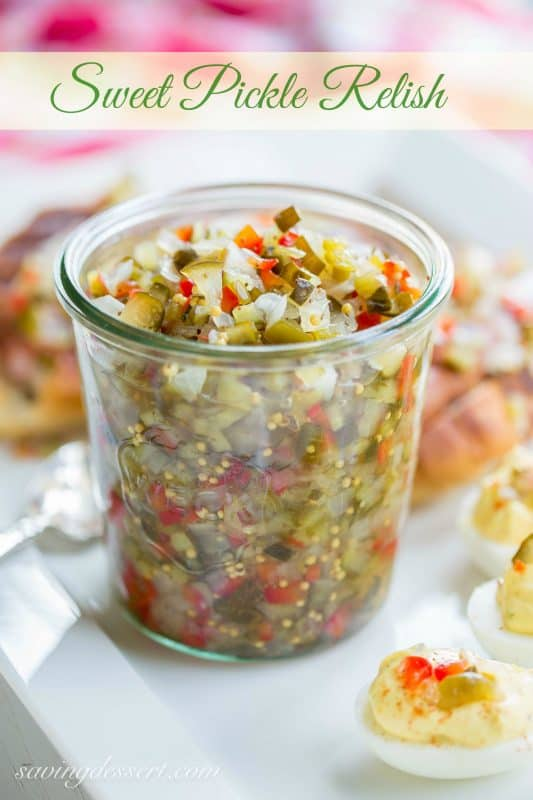 Homemade Sweet Pickle Relish - made with fresh from the garden cucumbers. Delicious served on hot dogs, deviled eggs or in all your summer salads. www.savingdessert.com