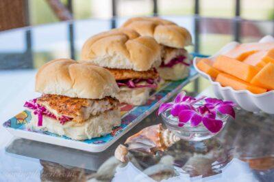 Blackened Grouper Sandwich alongside Purple Slaw as well as Swiss Cheese Grilled Blackened Grouper Sandwich