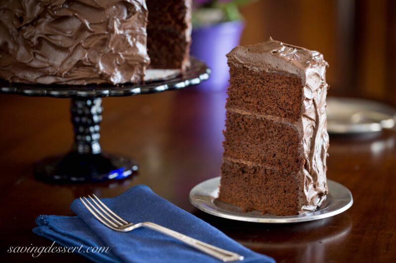 Chocolate Stout Cake ~An impressive chocolate stout layer cake topped with a creamy, rich dark chocolate buttercream frosting. www.savingdessert.com