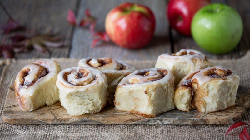 Apple Cinnamon Rolls amongst an Apple Cider Glaze  Apple Cinnamon Rolls amongst Apple Cider Glaze