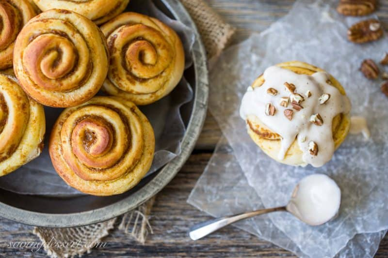 Pumpkin Butter Cinnamon Buns with cream cheese icing spiced with cinnamon, ginger, allspice and nutmeg