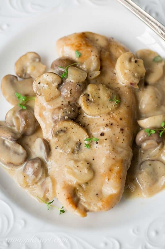 Skillet Chicken with a Mushroom Wine Sauce - fork tender and delicious! | www.savingdessert.com