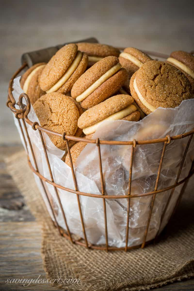 A basket of soft ginger molasses cookies filled with pumpkin butter buttercream icing
