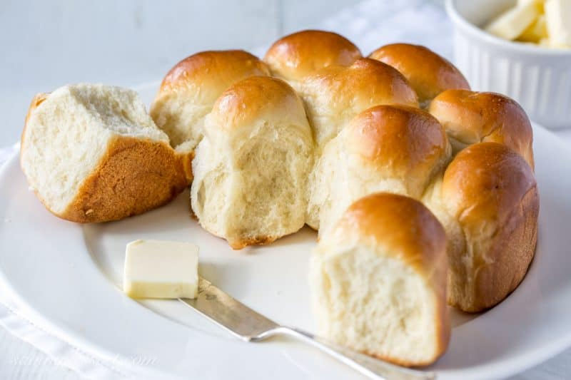 A plate of homemade rolls with butter
