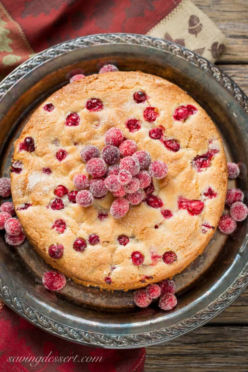 A cranberry almond breakfast cake topped with sugared cranberries