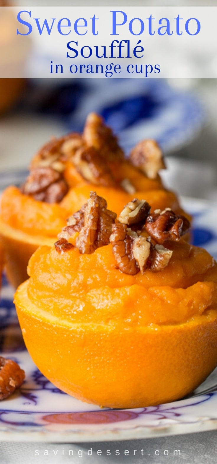 Sweet potato casserole served in orange cups and topped with sugared pecans