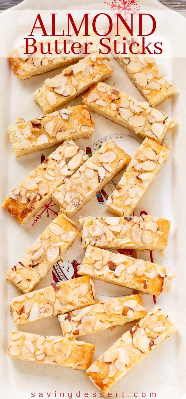 A plate of almond butter sticks topped with sliced almonds