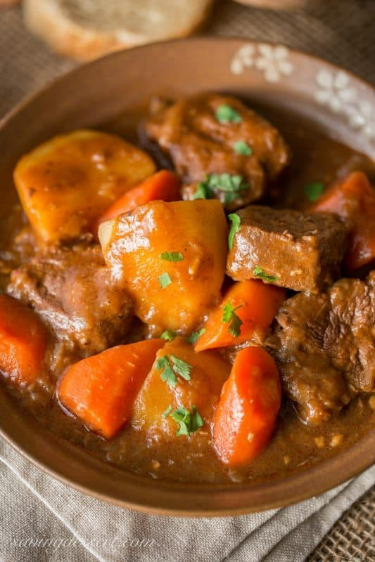 Beef stew with chunks of potatoes and carrots in a rich meaty broth