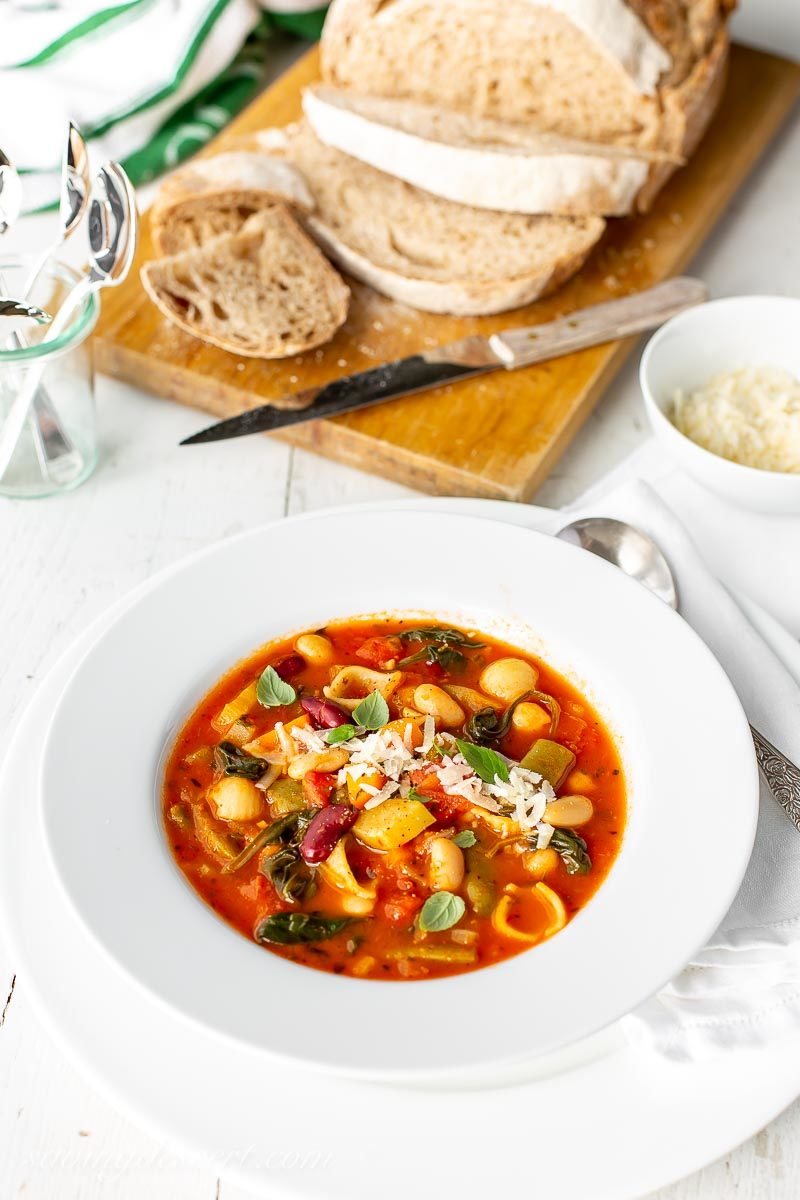 A bowl of easy Minestrone Soup with crusty bread and Parmesan