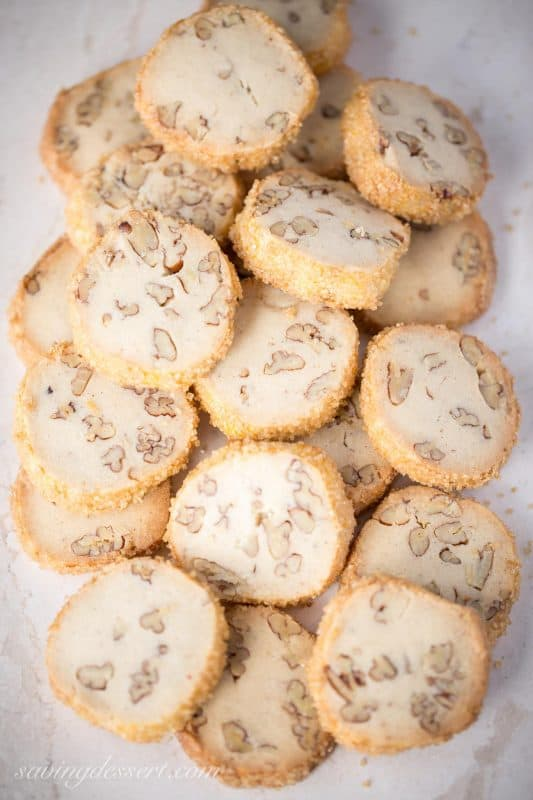 "Pecan Sandies ~ Classic shortbread cookies filled with toasted pecans and vanilla beans with a crisp coating of coarse sugar make these a wonderful and delicious ""perfect anytime cookie."" www.savingdessert.com"