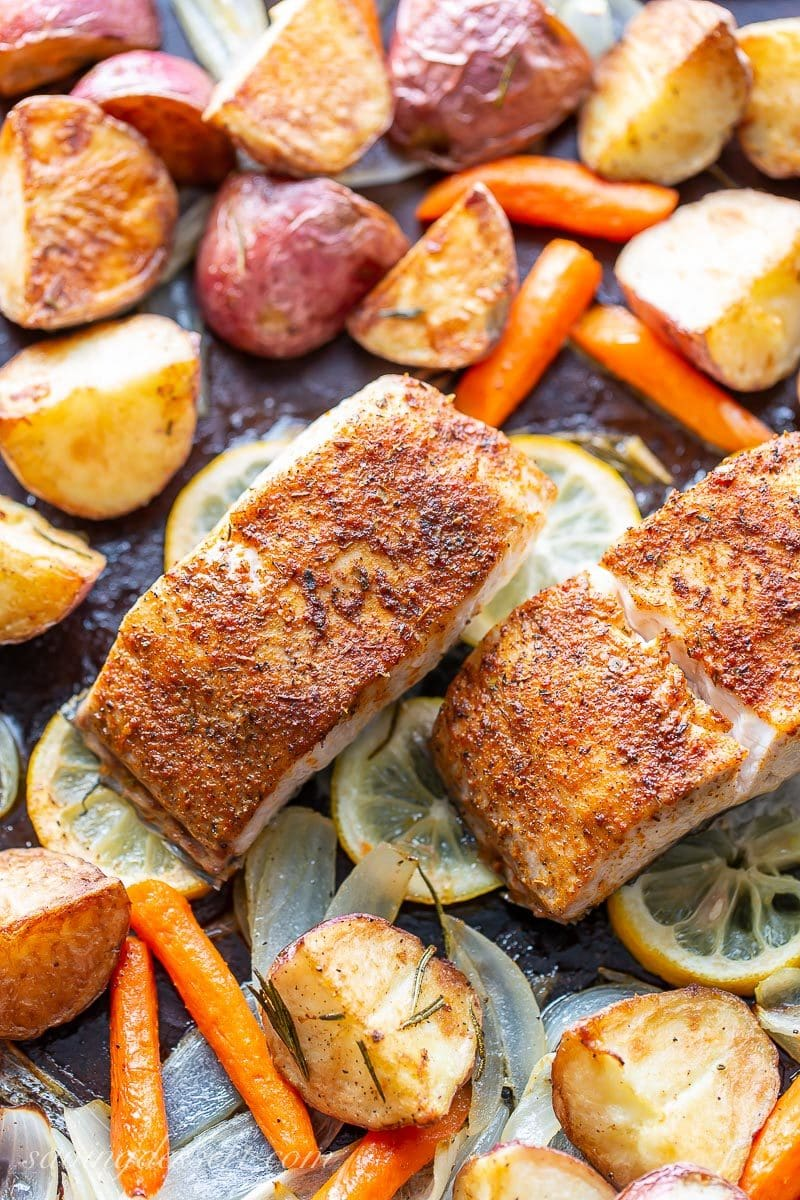 Baked fish and vegetables on a sheet pan