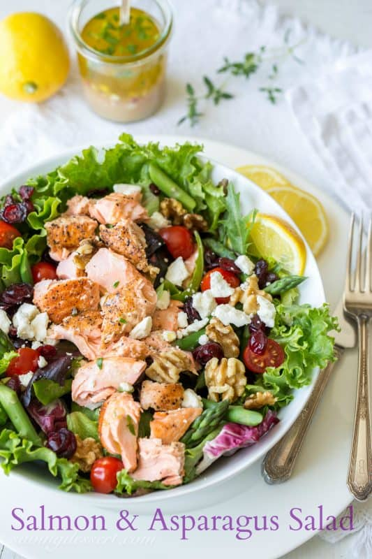 Salmon & Asparagus Salad with Feta cheese, cranberries, and walnuts. A fancy restaurant quality salad at home!