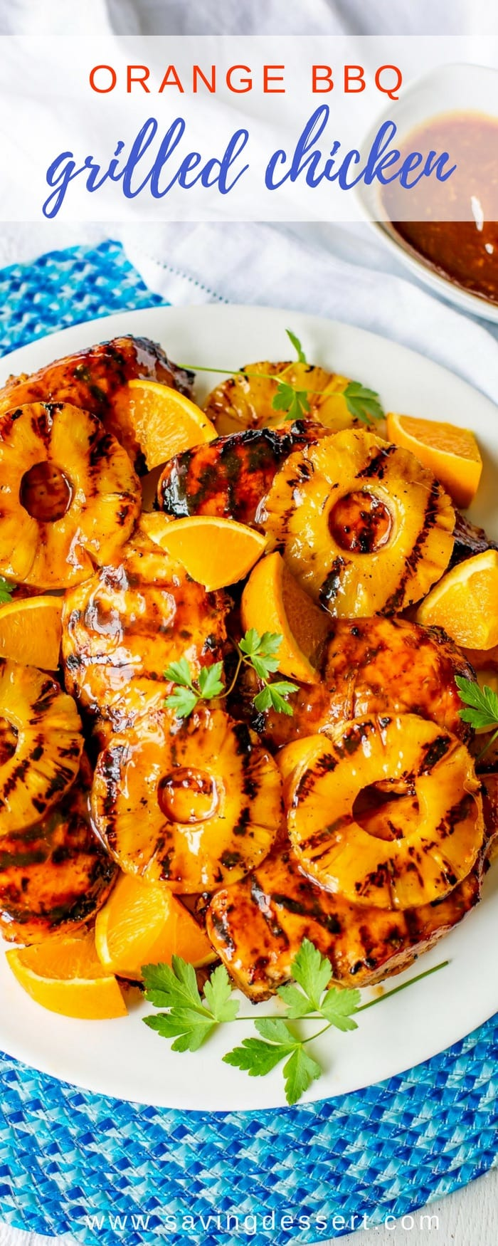 Fresh off the grill!  This Orange Barbecue Grilled Chicken Recipe is deliciously different and a breeze to throw together in a flash. We love the bright orange flavor and the hint of ginger and pineapple juice in the sauce. It's lip smacking good! #savingroomfordessert #grilled #chicken #grilledchicken #orangechicken #bestgrilledchicken #orangebarbecue #bbqchicken